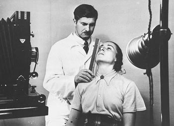 The facial features of a young German woman are measured during a racial examination. [Photograph #78569]